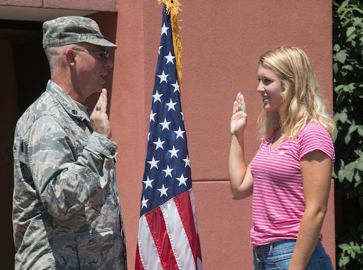 Cara Anderson, recites the Oath of Enlistment given by Lt. Col. Stan Paregien, 932nd Airlift Wing Public Affairs officer, July 17, 2019, Scott Air Force Base, Illinois. Anderson will soon begin her next chapter in her Air Force story. She said she was always interested in joining the military and enjoys helping others. Anderson is looking forward to the new life style and hopes to one day become a chief master sergeant in the Air Force. (U.S. Air Force photo by Senior Airman Melissa Estevez)