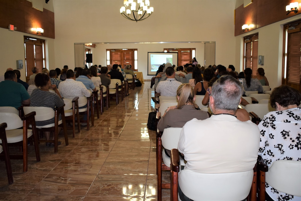 Image taken from the back of the room, approximately 100 attendants seating facing the front of the room.