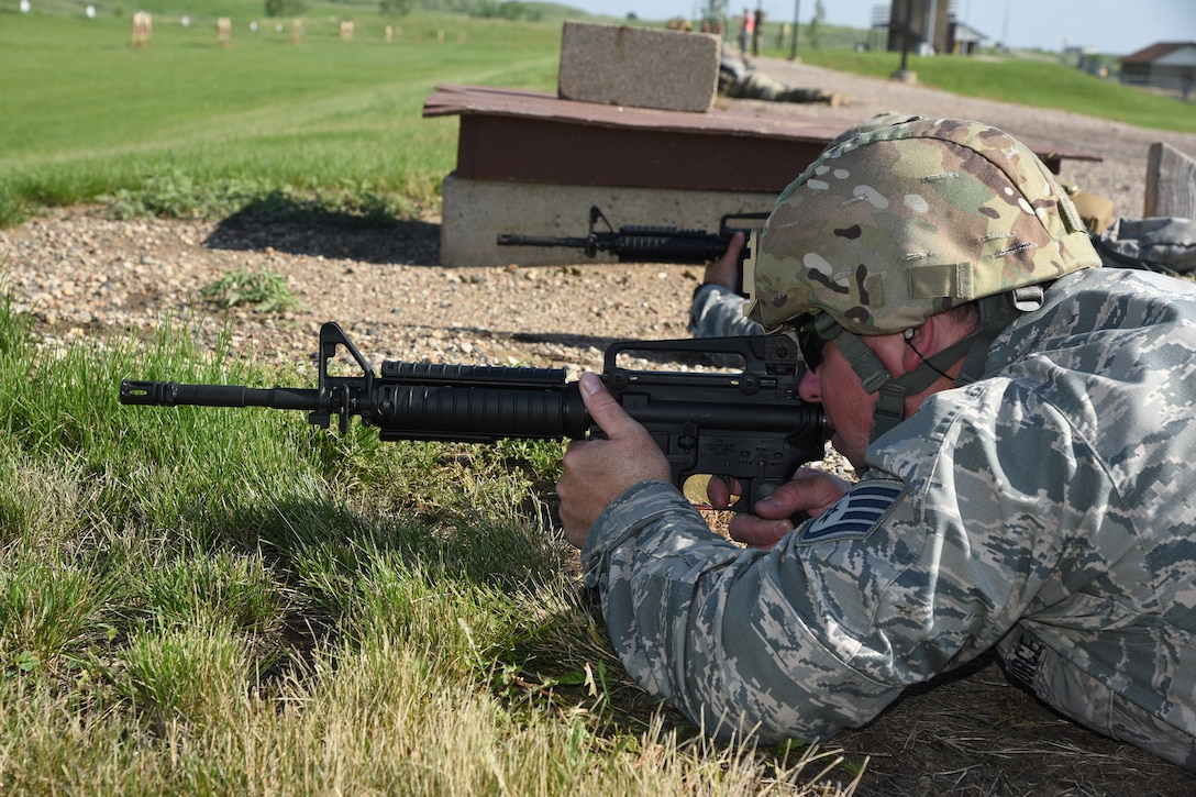 Staff Sgt. Tyrel Hoppe, of the 119th Wing, at the 2019 Adjutant General's Combat Marksmanship Match at the Camp Grafton firing complex, near McHenry, North Dakota. Hoppe is a member of the top shooting team at the annual North Dakota National Guard shooting competition and had top scores in the categories of Rifle Reflexive Fire, Rifle Run And Gun, and Rifle Excellence In Competition.