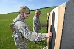 Staff Sgt. Cody Dewandeler, left, and Staff Sgt. Tyrel Hoppe, both of the 119th Wing, at the 2019 Adjutant General's Combat Marksmanship Match at the Camp Grafton firing complex, near McHenry, North Dakota. They are members of the top shooting team at the annual North Dakota National Guard shooting cometition.