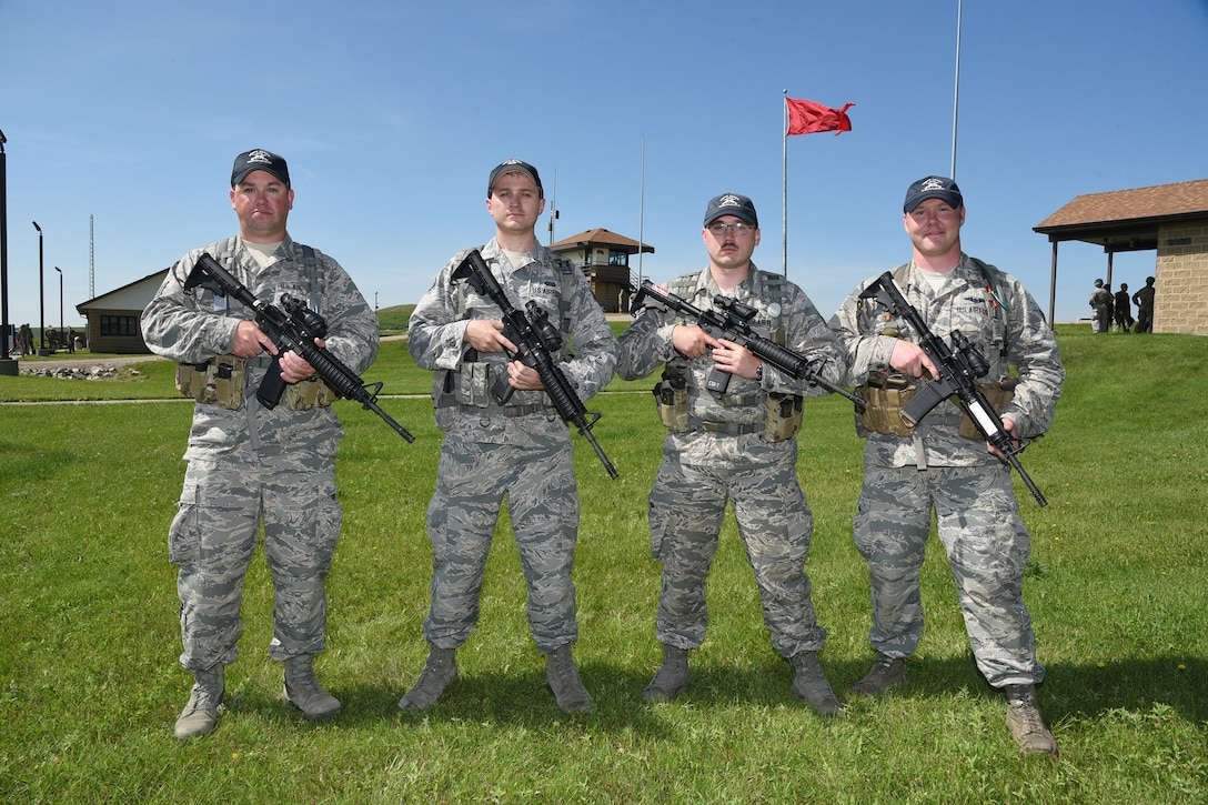 119th Wing Alpha Team members from left to right Staff Sgt. Tyrel Hoppe, Staff Sgt. Daniel Schur, Staff Sgt. Cody DeWandeler and Staff Sgt. Gavin Rook.at the 2019 Adjutant General's Combat Marksmanship Match at the Camp Grafton firing complex, near McHenry, North Dakota. They are members of the top shooting team at the annual North Dakota National Guard shooting competition.