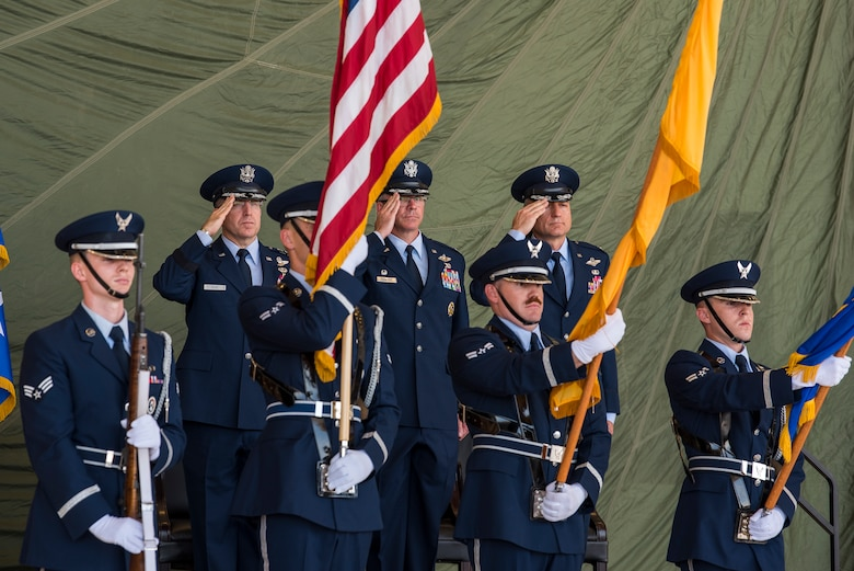 The official party salutes during the 27th Special Operations Wing change of command ceremony, July 17, 2019, at Cannon Air Force Base, N.M. Col. Robert Masaitis took command from the outgoing commander, Col. Stewart Hammons. (U.S. Air Force photo by Senior Airman Vernon R. Walter III)