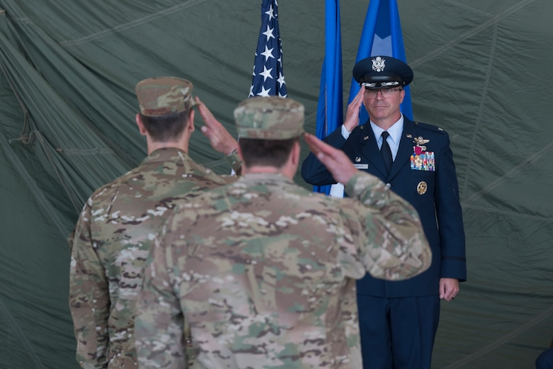 Col. Stewart A. Hammons, former 27th Special Operations Wing commander, receives his final salute during the 27th Special Operations Wing change of command ceremony, July 17, 2019, at Cannon Air Force Base, N.M. Col. Robert A. Masaitis took command from the outgoing commander, Hammons. (U.S. Air Force photo by Senior Airman Vernon R. Walter III)