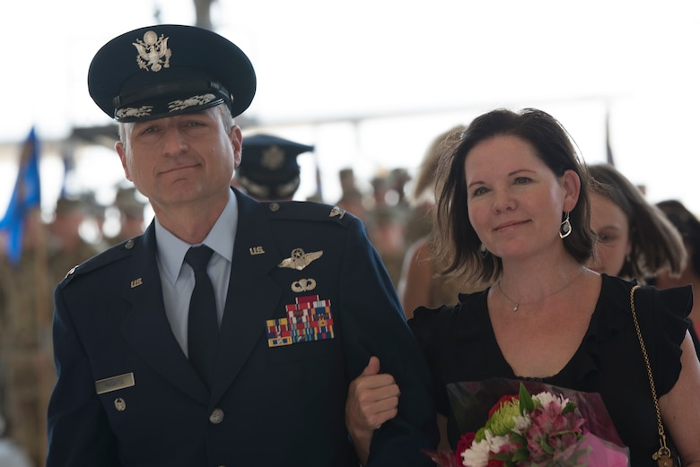 Col. Robert A. Masaitis, incoming 27th Special Operations Wing commander, departs the change of command ceremony with his spouse, Julie, July 17, 2019, at Cannon Air Force Base, N.M. Col. Robert Masaitis took command from the outgoing commander, Col. Stewart Hammons. (U.S. Air Force photo by Senior Airman Vernon R. Walter III)