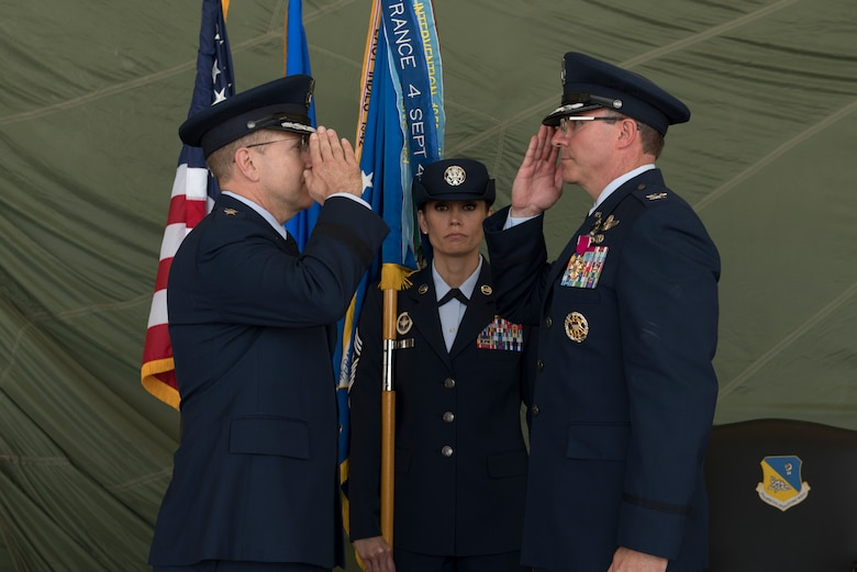Lt. Gen. Jim Slife, Air Force Special Operations Command commander, receives a salute from Col. Stewart Hammons, former 27th Special Operations Wing commander, during the change of command ceremony, July 17, 2019, at Cannon Air Force Base, N.M. Col. Robert Masaitis took command from the outgoing commander. (U.S. Air Force photo by Senior Airman Vernon R. Walter III)