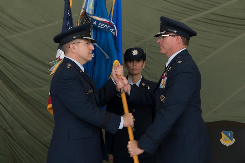 Lt. Gen. Jim Slife, Air Force Special Operations Command commander, receives the 27th Special Operations Wing guidon from Col. Stewart Hammons, former 27th SOW commander, during the change of command ceremony, July 17, 2019, at Cannon Air Force Base, N.M. Col. Robert Masaitis took command from the outgoing commander. (U.S. Air Force photo by Senior Airman Vernon R. Walter III)