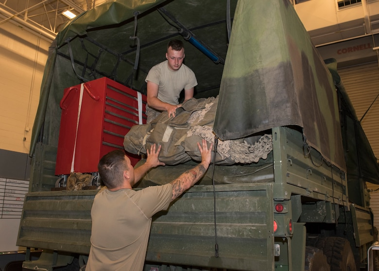 Senior Airman Tyler Duggar, 726th Air Control Squadron, and Senior Airman Randy Johnston, 726th ACS, load suppliies onto a Medium Tactical Vehicle in preparation for an exercise July 7, 2019, at Mountain Home Air Force Base, Idaho. The 726th ACS Conducts deployment exercises in order to increase their mission readiness. (U.S. Air Force photo by Senior Airman Tyrell Hall)