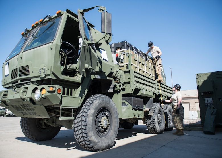 Airmen from the 726th Air Control Squadron conduct a height inspiection on a Medium Tactical Vehicle in preparation for an execise July 11, 2019, at Mountain Home Air Force Base, Idaho. Inspections are conducted throught the packing process to ensure vehicels adhere to regualtions and supplies are secure. (U.S. Air Force photo by Senior Airman Tyrell Hall)