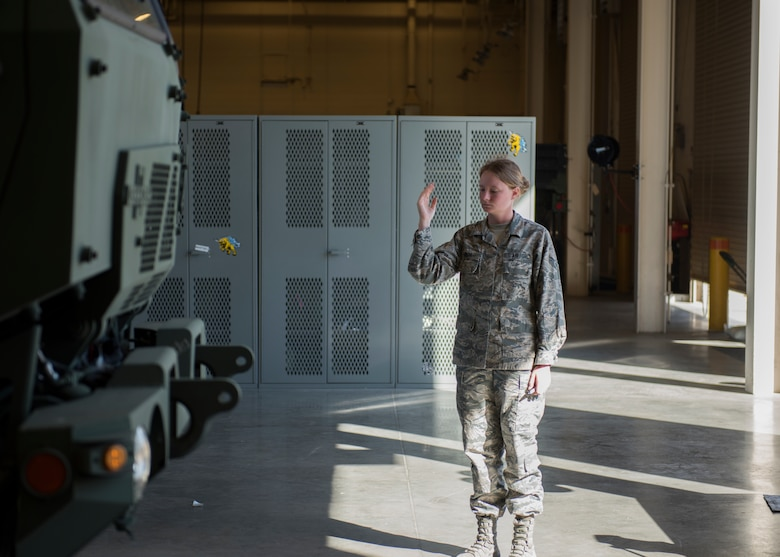 Airman Alexis Smith, 726th Air Control Squadron, guides a Medium Tactical Vehicle onto weight scales to conduct a weight inspection July 11, 2019, at Mountain Home Air Force Base Idaho. The 726th ACS conducts weight inspections in order to ensure the vehicle adheres to weight standards. (U.S. Air Force photo by Senior Airman Tyrell Hall)