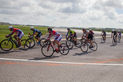 Cyclists race against one another on Marine Corps Air Station Futenma, Okinawa, Japan, July 14, 2019. Cyclists were racing the 2019 Futenma Bike Race; a competition that invites Status of Forces Agreement personnel and the local Okinawan community to compete on and around MCAS Futenma's airfield. (U.S. Marine Corps photo by Cpl. Christopher A. Madero) (U.S. Marine Corps photo by Cpl. Christopher A. Madero)