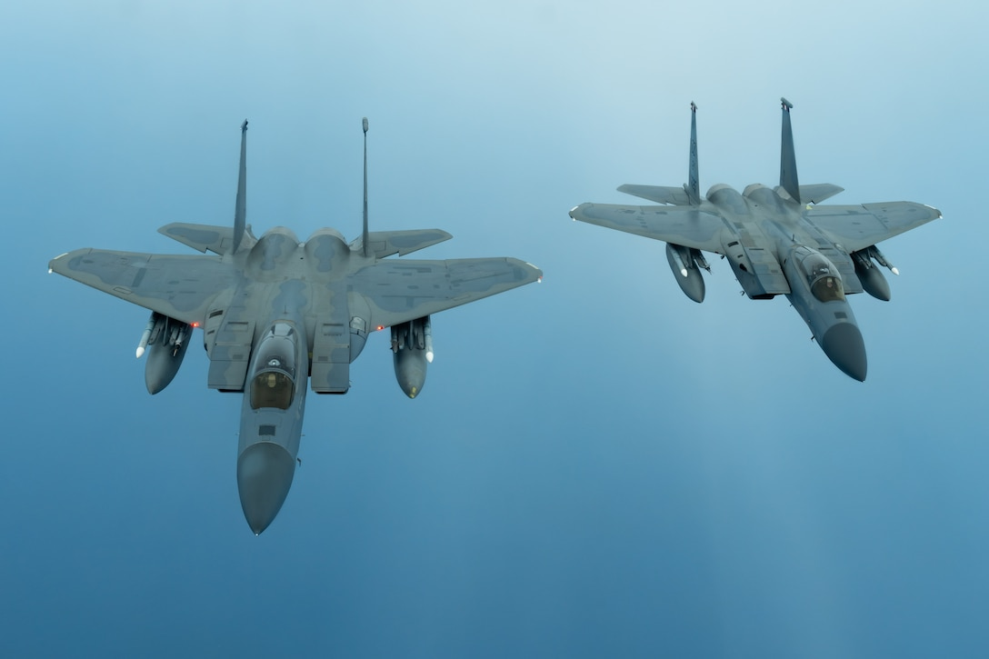 Two F-15C Eagles from the 44th Fighter Squadron fly during a training exercise July 10, 2019, out of Kadena Air Base, Japan. The Eagle can be armed with several combinations of different air-to-air weapons: AIM-120 AMRAAM advanced medium-range air-to-air missiles on its lower fuselage corners, AIM-9M/X Sidewinder or AIM-120 AMRAAM missiles on two pylons under the wings, and an internal 20 millimeter (0.79 in) M61 Vulcan Gatling gun in the right wing root. (U.S. Air Force photo by Airman 1st Class Matthew Seefeldt)