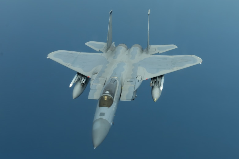 An F-15C Eagle from the 44th Fighter Squadron flies during a training exercise July 10, 2019, out of Kadena Air Base, Japan. The Eagle can be armed with several combinations of different air-to-air weapons: AIM-120 AMRAAM advanced medium-range air-to-air missiles on its lower fuselage corners, AIM-9M/X Sidewinder or AIM-120 AMRAAM missiles on two pylons under the wings, and an internal 20 millimeter (0.79 in) M61 Vulcan Gatling gun in the right wing root. (U.S. Air Force photo by Airman 1st Class Matthew Seefeldt)