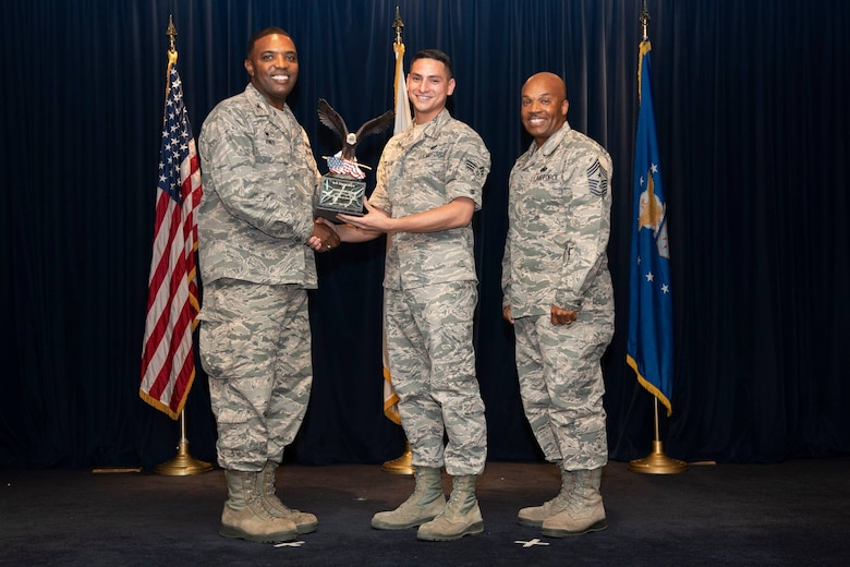 Senior Airman Shawn Clark, 374th Communications Squadron cyber operations technician,  is presented the Airman level 2nd Quarter 2018 award by Col. Otis C. Jones, 374th Airlift Wing commander, at Yokota Air Base, Japan, Aug. 2, 2018.