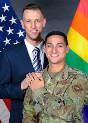 Nathan Evans, 374th Force Support Squadron UNITE program community cohesion coordinator, left, and Shawn Clark, 374th Communications Squadron cyber operations technician, right, pose for a photo at Yokota Air Base, Japan, July 17, 2019.