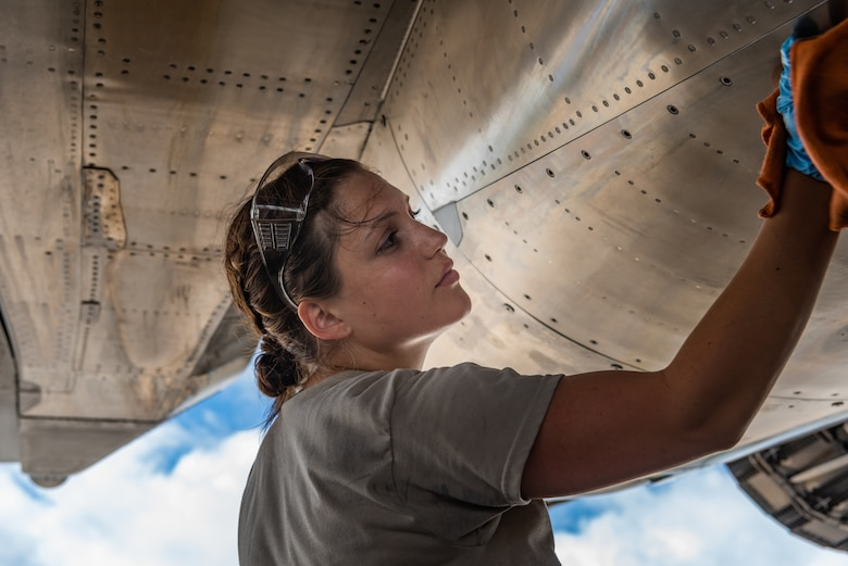 U.S. Air Force Airman 1st Class Hannah Cayton, F-15C Eagle assistant dedicated crew chief assigned to the 44th Aircraft Maintenance Unit, cleans an aircraft during pre-flight inspections July 2, 2019, on Kadena Air Base, Japan. The life of a dedicated crew chief requires non-stop dedication, day and night, to maintain air-to-air combat superiority. (U.S. Air Force photo by Senior Airman Cynthia Belío)