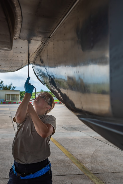 U.S. Air Force Airman 1st Class Hannah Cayton, F-15C Eagle assistant dedicated crew chief assigned to the 44th Aircraft Maintenance Unit, checks panel security during pre-flight inspections July 2, 2019, on Kadena Air Base, Japan. Members of the 44th AMU are vital to the 18th Wing's mission, as they spearhead the protection of a free and open Indo-Pacific region by keeping its aircraft in the air. (U.S. Air Force by Senior Airman Cynthia Belío)