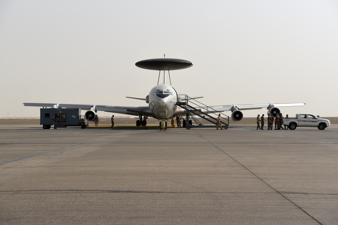 Crew chiefs assigned to the 380th Expeditionary Aircraft Maintenance Squadron remain with their E-3 Sentry Airborne Warning and Control System aircraft until it taxis for takeoff on Al Dhafra Air Base, United Arab Emirates, June 26, 2019.