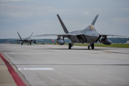 F-22 Raptors from the 1st Fighter Wing, 27th Fighter Squadron taxis for departure during a deployment to Al Udeid Air Base, Qatar, from Joint Base Langley-Eustis, Virginia. The F-22's deployed to Qatar for the first time in order to defend American forces and interests in the U.S. Central Command area of responsibility. (U.S. Air Force Photo by Airman First Class Monica Roybal)