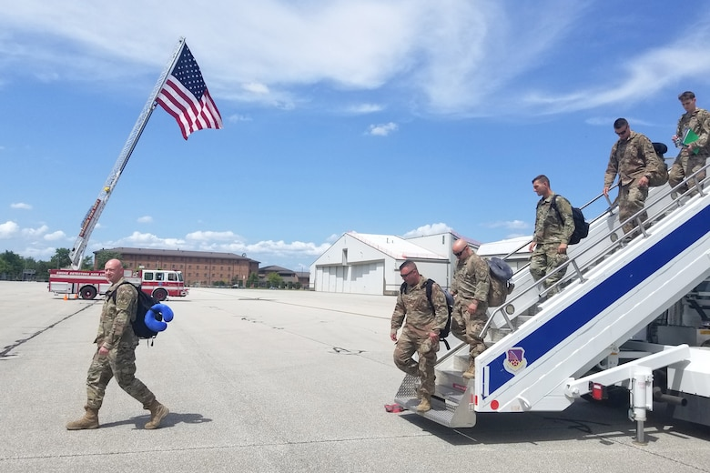 The Grissom Fire Department flies a U.S. flag for returning Airmen exiting their aircraft at Grissom Air Reserve Base, Indiana July 15, 2019. Sixteen Airmen from the 434th Air Refueling Wing were greeted and flown home by leadership after arriving at the Baltimore-Washington International airport. (U.S. photo/Ben Mota)