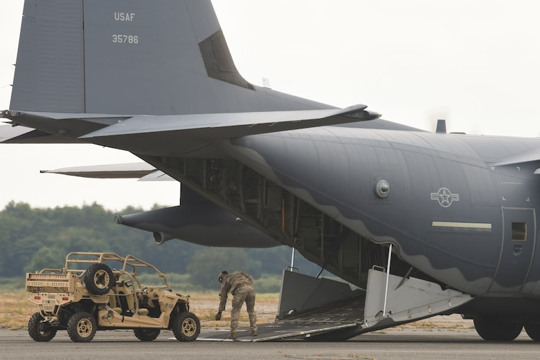 A U.S. Air Force loadmaster from the 67th Special Operations Squadron RAF Mildenhall, England, prepares to load an MRZR tactical all-terrain vehicle onto a MC-130J Commando II during the MC130J Rodeo competition, July 10, 2019, at RAF Sculthorpe. Loadmasters across seven different MC-130J crews were evaluated on their performance of vehicle infiltration/exfiltration. (U.S. Air Force photo by Airman 1st Class Joseph Barron