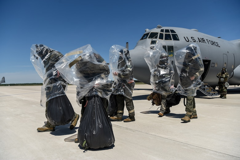 Aircrew members from the 123rd Airlift Wing simulate the evacuation of a C-130 Hercules aircraft in the event of a chemical contamination during an Operational Readiness Exercise at the Alpena Combat Readiness Training Center in Alpena, Mich., on June 23, 2019. The ORE demonstrated the wing's ability to mobilize, fly to a remote site, operate in a hostile stateside environment and re-deploy back home while being evaluated. (U.S. Air National Guard photo by Staff Sgt. Joshua Horton)