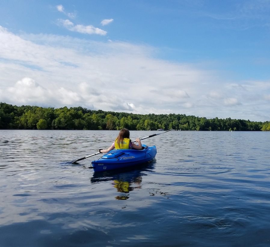 A young lake visitor kayaks for the first time at Rough River Lake
