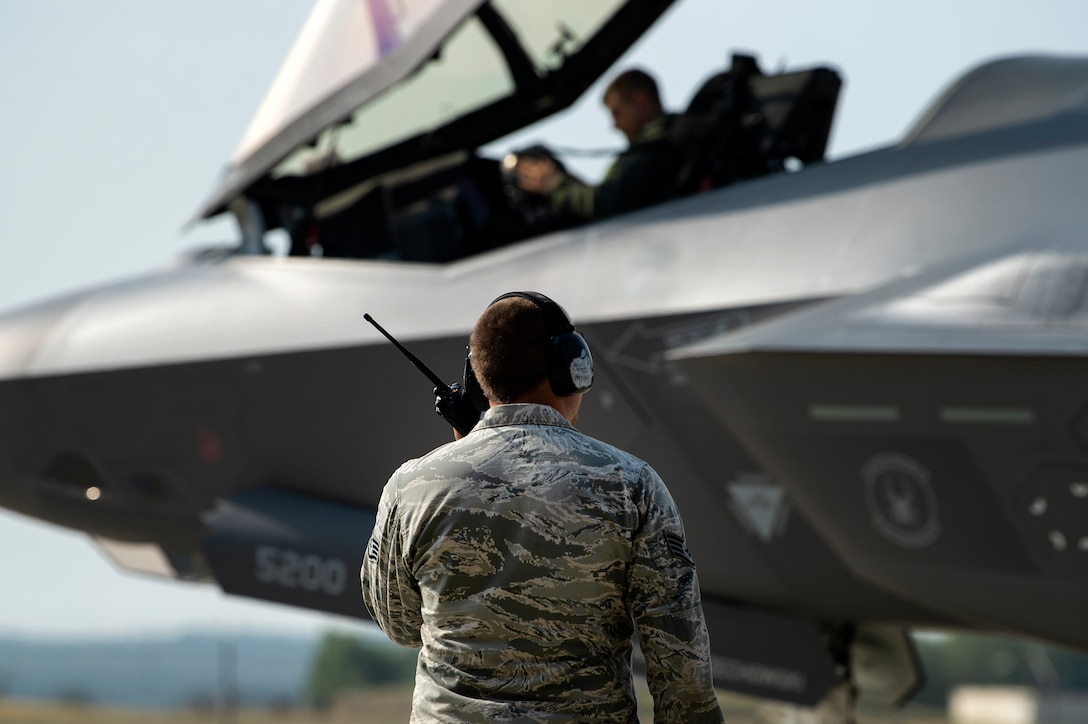 U.S. Air Force Capt. Joseph Walz, 421st Fighter Squadron F-35A Lightning II pilot, and Staff Sgt. David Sasak, 421st FS crew chief, conduct a pre-flight check during Operation Rapid Forge at Spangdahlem Air Base, Germany, July 18, 2019. Rapid Forge aircraft are forward deploying to train in coordination with NATO allies. Conducting exercises and operations with allied forces increases the U.S. Air Force's ability to quickly respond to potential threats. (U.S. Air Force photo by Airman 1st Class Valerie Seelye)