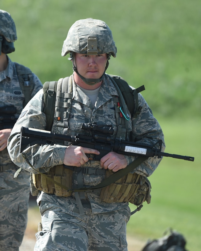 Senior Airman Gavin Rook, of the 119th Wing, moves into position during the 2019 North Dakota National Guard Adjutant General's Combat Marksmanship Match at the Camp Grafton Training Center firing complex, near McHenry, North Dakota, July 11, 2019. Rook has been accruing points over the past few years shooting, winning and placing at accreted excellence in competition (EIC) matches and this competition earned him enough points to achieve Distinguished Marksmanship Badges in both rifle and pistol shooting. At age 22, Rook is the youngest North Dakota National Guard shooter to earn the Distinguished Marksmanship Badge in both rifle and in pistol. He is believed to be the first North Dakota Air National Guard member to 'go double-distinguished.'