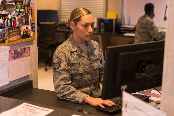 "Tech. Sgt. Michele Lazurka, 47th Medical Operations Squadron flight medicine office manager, sits at the front desk awaiting patients at the medical clinic at Laughlin Air Force Base, Texas, on July 10, 2019. Leadership awarded Lazurka the ""XLer"" of the week for her hard work in the clinic and hours spent adding to the success of the Wing's 5/6 club. (U.S. Air Force photo by Senior Airman Anne McCready)"