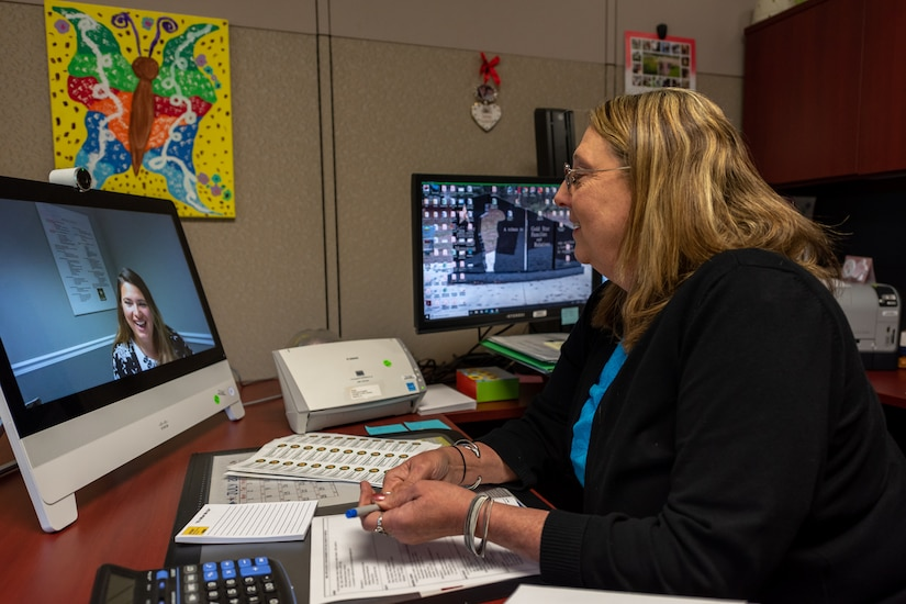 Photo of Linda Kerr, Social Services Program manager, demonstrates how the new video chat technology can connect Soldiers and their families at Picatinny Arsenal, New Jersey, to ACS program managers at Tobyhanna Army Depot.