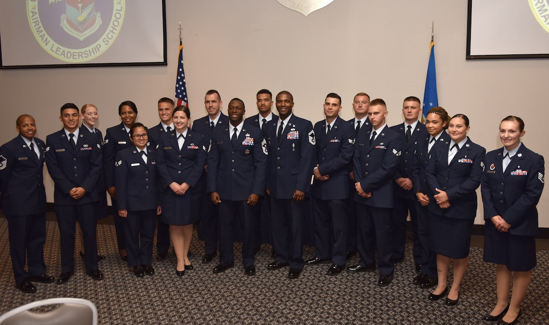 The Airman Leadership Class 19-E gather after their graduation ceremony for a group photo at the event center on Goodfellow Air Force Base, Texas, July 11, 2019. ALS is a six-week course designed to prepare senior airmen for supervisory duties by offering instruction in leadership, followership, written and oral communication skills, and the profession of arms. (U.S. Air Force photo by Senior Airman Seraiah Wolf/Released)
