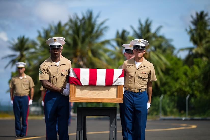 Marines carry casket.