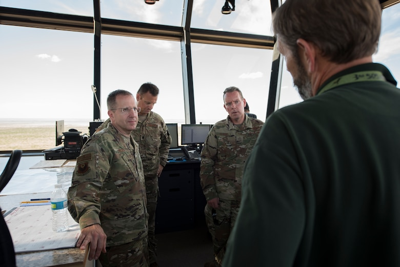 Lt. Gen. Jim Slife, Air Force Special Operations Command commander, and Chief Master Sgt. Cory Olson, AFSOC command chief, receive a briefing on the capabilities of the air traffic control tower at Melrose Air Force Range, N.M., from Steve Coffin, 27th Special Operations Air Operations Squadron director of MAFR, July 15, 2019. Slife and Olson toured the range and facilities utilized by Air Commandos. Before the tour, Slife and Olson met with local and state leaders. (U.S. Air Force photo by Senior Airman Vernon R. Walter III)