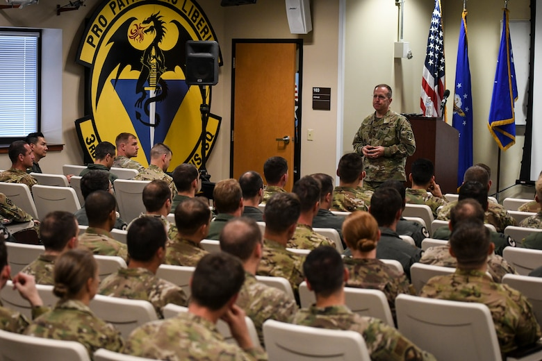 Lt. Gen. Jim Slife, Air Force Special Operations Command commander, speaks to a group of Airmen from Cannon Air Force Base, N.M., July 15, 2019. During his visit, Slife explained his goals for AFSOC during his command and took questions from the audience. During the second day of his trip, Slife toured the Remote Piloted Aircraft Operations Center and the 26th Special Tactics Squadron to see the mission and the Airmen that perform it firsthand. (U.S. Air Force photo by Senior Airman Lane T. Plummer)