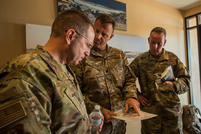 Lt. Gen. Jim Slife, Air Force Special Operations Command commander, and Chief Master Sgt. Cory Olson, AFSOC command chief, receive an initial briefing at Melrose Air Force Range from Lt. Col. Michael Janssen, 27th Special Operations Air Operations Squadron commander, at Cannon Air Force Base, N.M., July 15, 2019. During the tour, Slife saw how Cannon's Air Commandos utilize MAFR for training. Slife visited the range's air traffic control tower, command facility, and exercise locations. (U.S. Air Force photo by Senior Airman Vernon R. Walter III)
