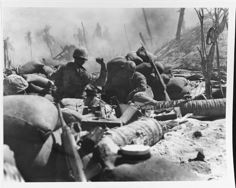 Marine throws grenade.