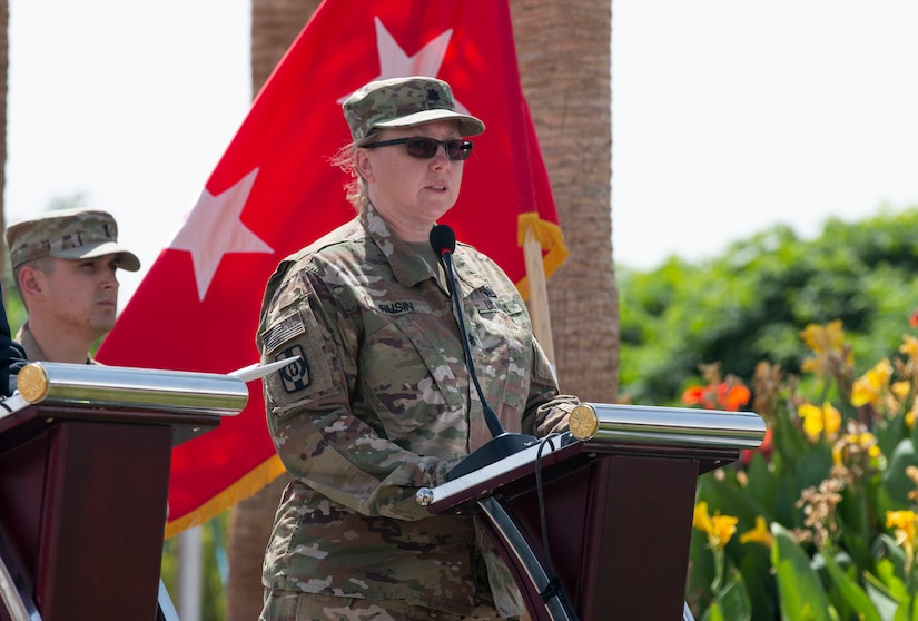 U.S. Army Lt. Col. Theresa Rusin speaks during the Transfer of Authority where the 655 Regional Support Group (RSG), Army Reserve unit based out of Westover Air Reserve Base, assumes command of Area Support Group Jordan from the 198 RSG, Arizona National Guard, July 18, 2019 at the Joint Training Center.