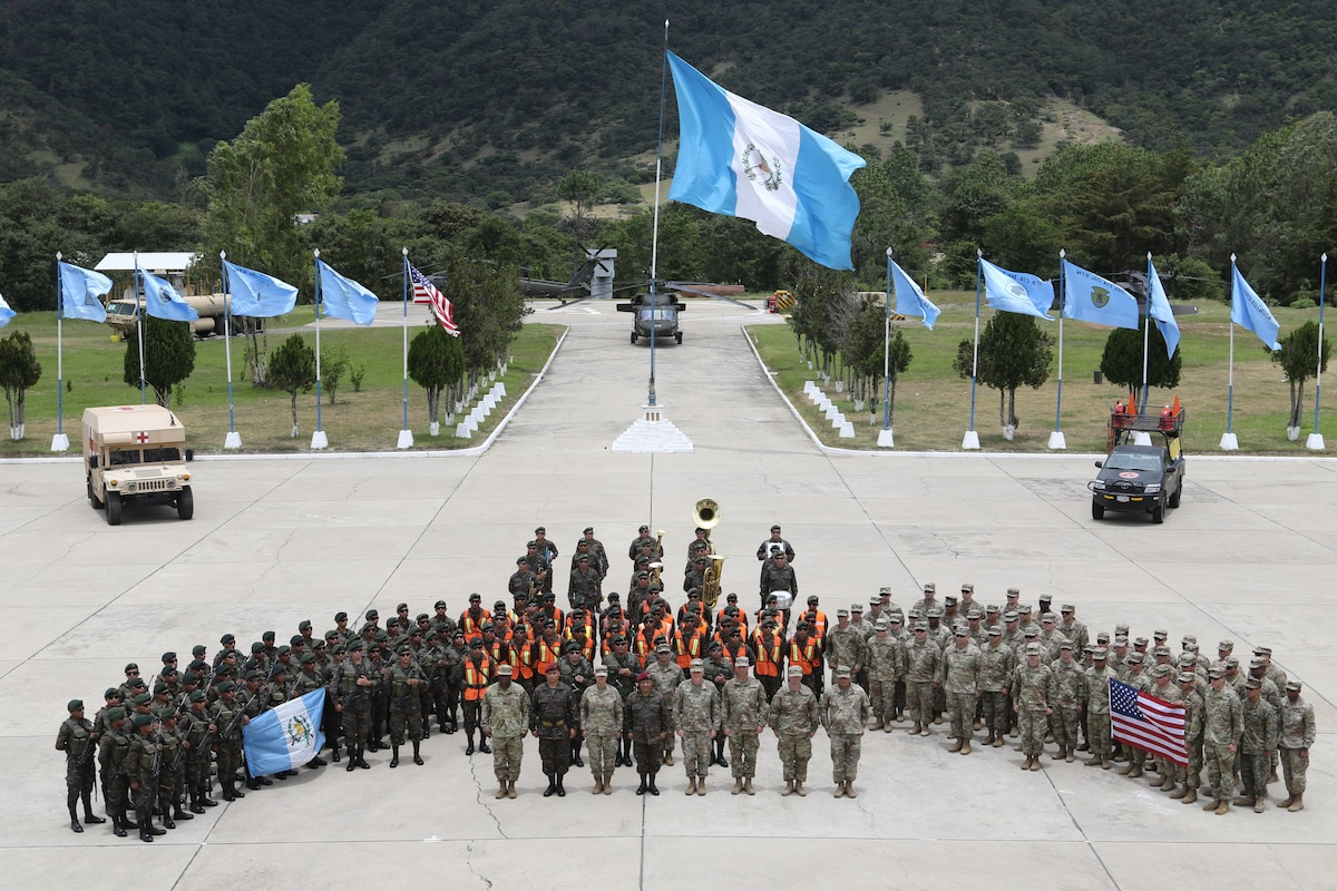 A large group of military personnel pose for a picture