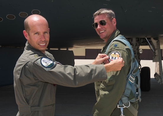 Col. Matthew Calhoun, the 131st Bomb Wing vice commander, presented Lt. Col. Timothy B. Rezac, commander of the 110th Bomb Squadron, with a commemorative patch on July 2, 2019, at Whiteman Air Force Base, Missouri. Rezac became the 14th ever B-2 Spirit pilot to reach 1500 flight hours in the stealth bomber. (U.S. Air Force photo by Senior Airman Ashley Adkins)