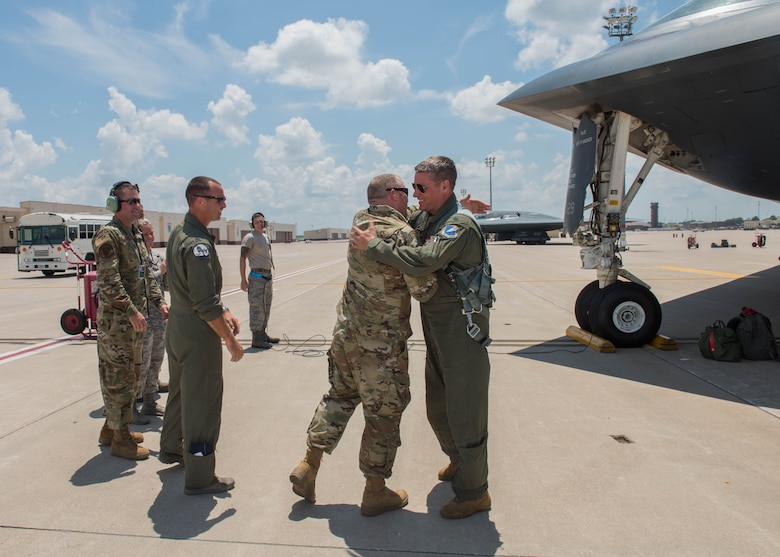 Airmen greet Lt. Col. Timothy B. Rezac, commander of the 110th Bomb Squadron, on July 2, 2019, at Whiteman Air Force Base, Missouri. Rezac became the 14th ever B-2 Spirit pilot to reach 1500 flight hours in the stealth bomber. (U.S. Air Force photo by Senior Airman Ashley Adkins)