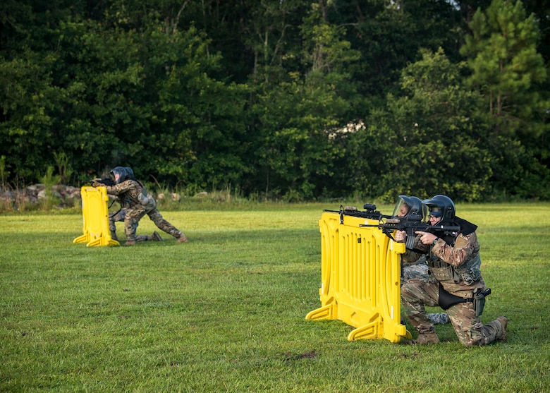 "Airmen from the 23d Security Forces Squadron (SFS), defend their positions during a training exercise, July 15, 2019, at Moody Air Force Base, Ga. The ""Shoot, move, communicate"" training exercise put participants through practice maneuvers taking turns providing cover fire while others advanced on the enemy. Airmen learned how to shoot, move and communicate to build confidence in themselves, their wingmen and with their weapons. (U.S. Air Force photo by Airman 1st Class Eugene Oliver)"