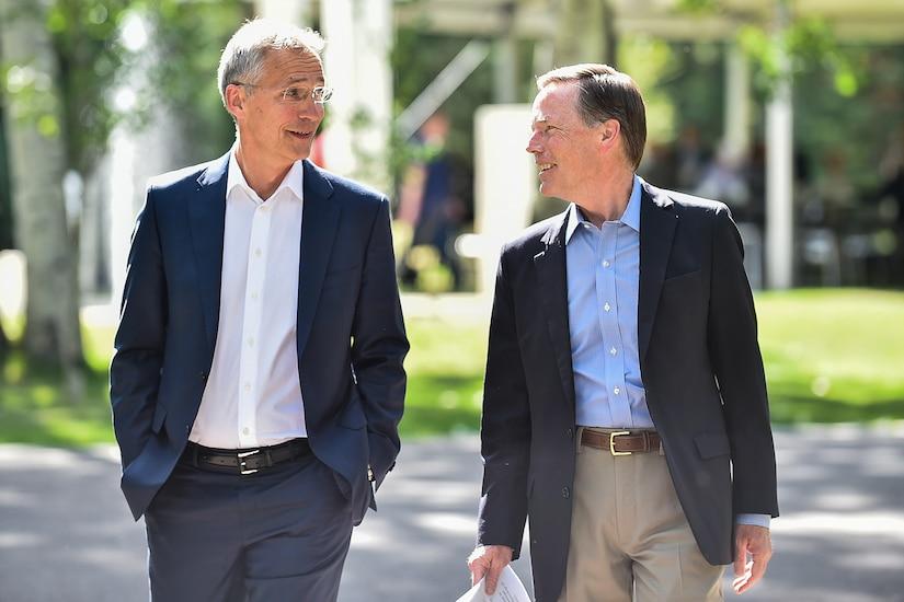Two men walking and talking.