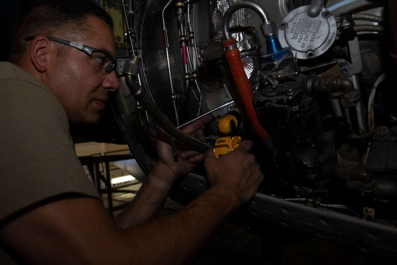 Staff Sgt. George Brennan, a 302nd Maintenance Squadron aerospace propulsion technician, replaces components on a C-130 Hercules aircraft during an isochronal inspection at Peterson Air Force Base, Colorado, July 8, 2019.