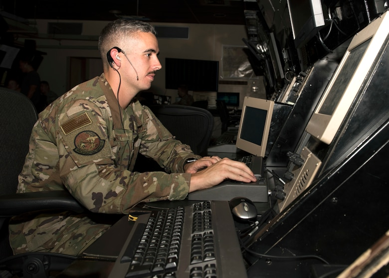 Staff Sgt. George Garrett, 56th Operation Support Squadron air traffic controller, plots the location of aircraft on a radar scope July 10, 2019, at Luke Air Force Base, Ariz.
