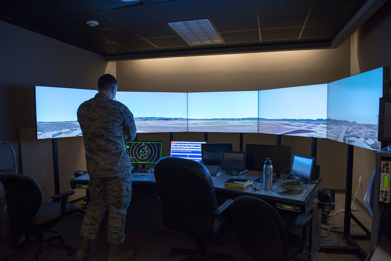 Airman 1st Class Richard Haselden, 56th Operation Support Squadron air traffic controller, uses a computer system to do aircraft simulation training July 15, 2019, at Luke Air Force Base, Ariz.