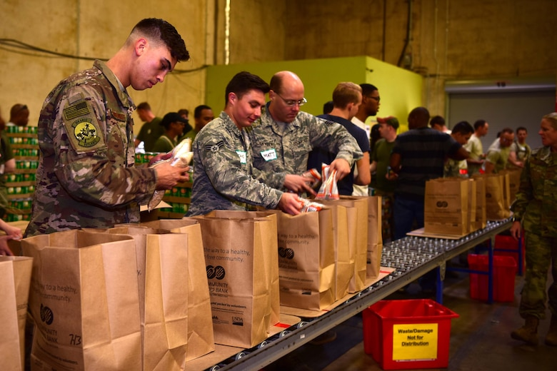 The reservists spent their Saturday morning supporting the needy, spanning five counties by building 3,360 food boxes at the Community Food Bank of Southern Arizona.