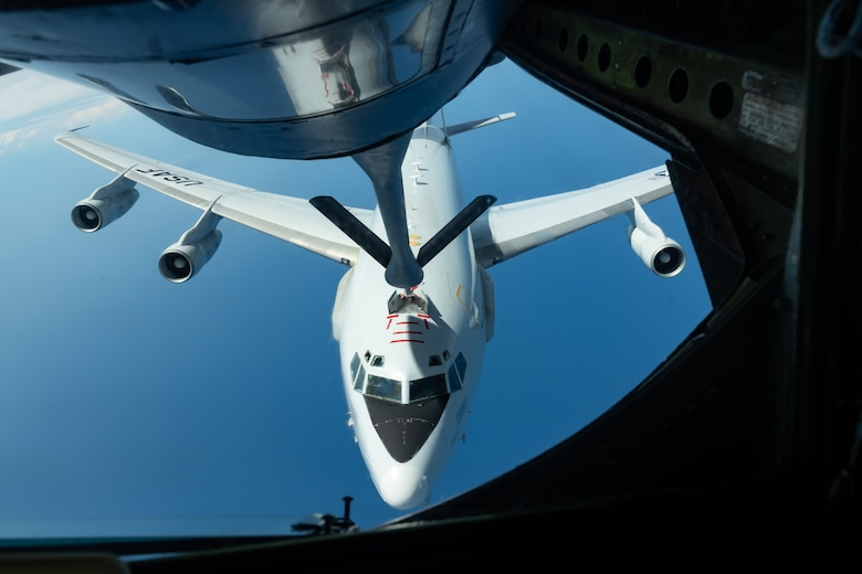 An E-3 Sentry from the 961st Airborne Air Control Squadron  refuels with a KC-135 Stratotanker from the 909th Air Refueling Squadron July 10, 2019, during a training exercise out of Kadena Air Base, Japan. The Sentry provides all-weather surveillance, command, control, and communications in support of a free and open Indo-Pacific. (U.S. Air Force photo by Airman 1st Class Matthew Seefeldt)