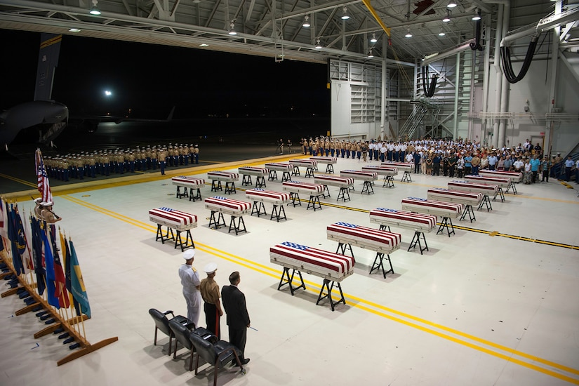 Service members stand during a repatriation ceremony.