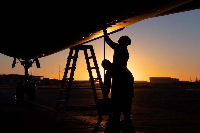 U.S. Air Force Staff Sgt. Ty Steinhausen, 605th Aircraft Maintenance Squadron, and USAF Tech. Sgt. Jerret Hupp, 305th AMXS, Joint Base McGuire-Dix-Lakehurst, New Jersey, perform routine pre-flight inspections of a USAF KC-10 prior to its departure July 16, 2019, at Brisbane International Airport, Australia. The Extender arrived July 12 to support major air operations for USAF, Royal Australian Air Force and U.S. Navy aircraft operating out of RAAF Base Amberley for Exercise Talisman Sabre 19, a biannual joint operation providing effective and intense training to ensure U.S. Forces are combat ready, capable, interoperable, and deployable on short notice.  (U.S. Air Force photo by Senior Airman Elora J. Martinez)