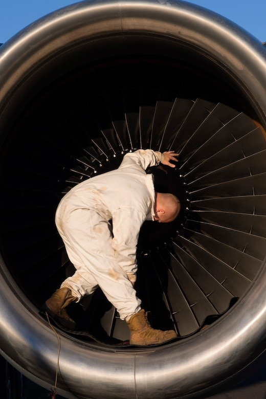 U.S. Air Force Staff Sgt.Ty Steinhausen, 605th Aircraft Maintenance Squadron, Joint Base McGuire-Dix-Lakehurst, New Jersey, performs routine maintenance checks on one of three turbine engines of a USAF KC-10 Extender July 16, 2019, at Brisbane International Airport, Australia. The Extender arrived July 12 to support major air operations for USAF, Royal Australian Air Force and U.S. Navy aircraft operating out of RAAF Base Amberley for Exercise Talisman Sabre 19, a biannual joint operation providing effective and intense training to ensure U.S. Forces are combat ready, capable, interoperable, and deployable on short notice.  (U.S. Air Force photo by Senior Airman Elora J. Martinez)